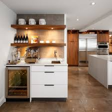 chic built in wine fridge featuring brown wooden kitchen cabinets