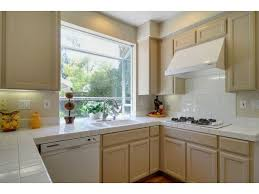 kitchen cabinet colors with beige countertops beige painted oak cabinets kitchens forum gardenweb