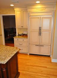 Base Cabinets Wood Paneled Refrigerator With A Wall Cabinet And Base Cabinet
