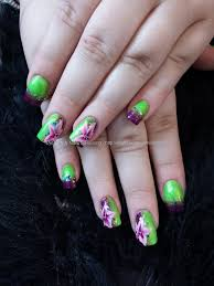 lime green and purple fade with one stroke flower nail art nails