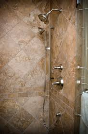 travertine with subway tile accent border showers pinterest