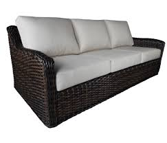 black deep seating wicker patio couch using white linen upholstery