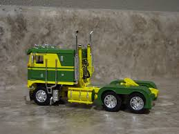 kenworth cabover history dcp 1 64 green yellow kenworth k 100 cabover semi truck farm toy