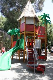 mega tower playground with incorporated rocks and ropes features
