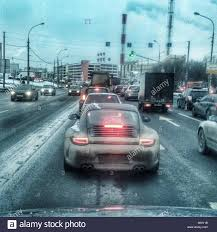 porsche winter porsche carrera on winter road moscow russia stock photo