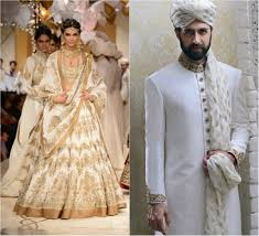 wedding clothes conventional style white bridal and groom attires for