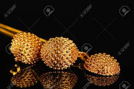 beautiful gold earrings beautiful gold earrings and necklace on black background stock
