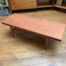 1960s long teak coffee table with lower slat shelf