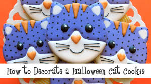 how to decorate a halloween cat face cookie youtube