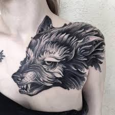shoulder tattooo wolf tattoo on the left shoulder and chest done at family ink