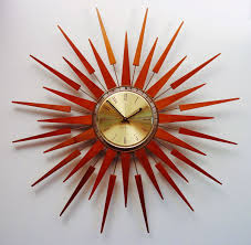 mid century modern starburst wall clock by seth thomas 1960s