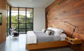 walls plated with laminate flooring panels or wood paneling archiki