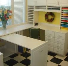 Desk With Pull Out Table Here U0027s A Sewing Craft Space With A U Shaped Desk Fitted Into A