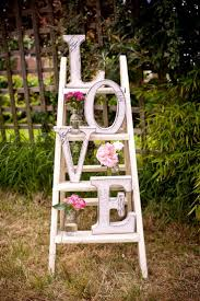 wedding arch ladder vintage white display made with white ladder pink flowers