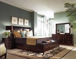 grey master bedroom dark red fur rug on te black floor showing white bed platform gray