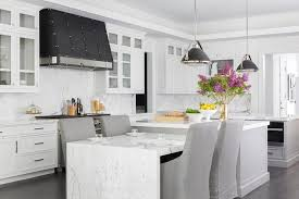 marble kitchen island table white kitchen with black range and two gray center islands