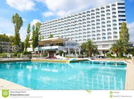 swimming pool and building of the luxury hotel royalty free stock
