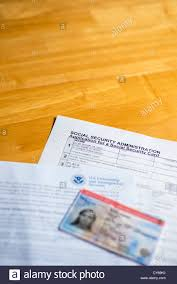 uscis ead card and approval notice on top of social security