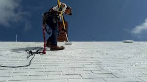 Surecoat Roof Coating by Applying The Second Coat Of Elastomeric Siliconized Roof Coating