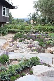 rock garden landscape mediterranean with gray siding contemporary