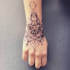 fist tattoo designs elegant wrist tattoo supakitch linework art beautiful body