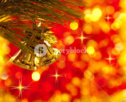 gold christmas tree decorations on lights red background royalty