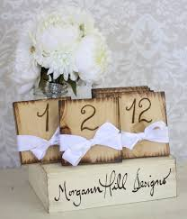 chic rustic wedding decor photograph rustic table numbers
