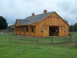 indoor riding arena and barn in cedar precise buildings