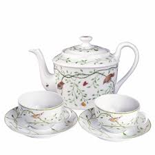 teapot set set of two tea cups saucers and teapot being