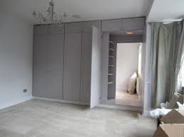 wardrobe doors reveal hidden dressing room containing additional