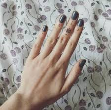 50 delicate and tiny finger tattoos to inspire your or