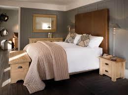 elegant brown leather bedroom headboard installed in the bed frame