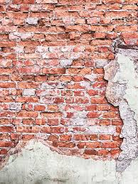 background texture from brick wall with cracked plaster stock