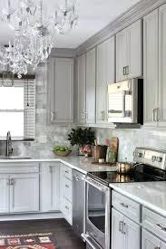 glass tiles for kitchen backsplashes light gray backsplash kitchen light gray kitchen cabinets light