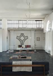 a romantic industrial milan loft for a bohemian design duo