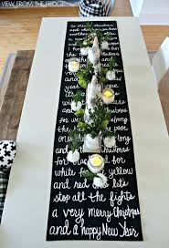 table setting runner and placemats christmas song lyric table runner and christmas table setting black