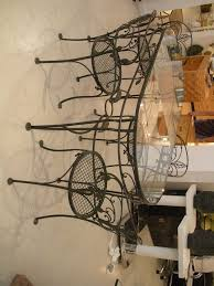 nice black color wrought iron kitchen table set with armless metal