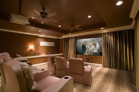 interior home theater room ideas with golden shaddy curtain on