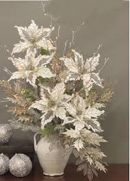 Led Branch Centerpieces by Lighted Silver Willow Branches In A Christmas Poinsettia