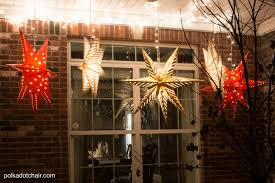 How To Put Christmas Lights On A Tree by Hanging Star Lanterns A Christmas Front Porch Decorating Idea