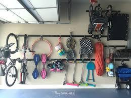 garage organizing how to hang bikes scooters ripsticks balls