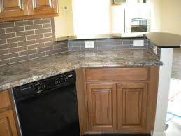 installing ceramic tile backsplash in kitchen ceramic tile backsplash stonelike monochrome kitchen leaf tile