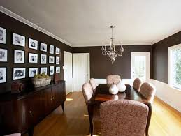 i like the wainscoting and the covered chairs with the dark wood