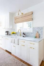 white kitchen cabinets with gold pulls pin on konyhák