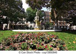 beautiful fountain in garden full of flowers stock photo search