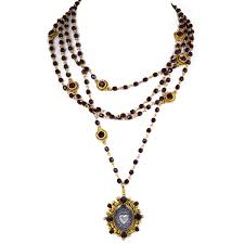 sacred heart jewelry virgins saints oval sacred heart magdalena vsa gold garnet