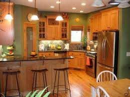 oak cabinet kitchen ideas honey oak kitchen cabinets with black countertops and green walls
