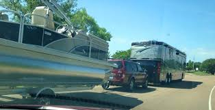 the griswolds are on the move rv pulling a car pulling a boat