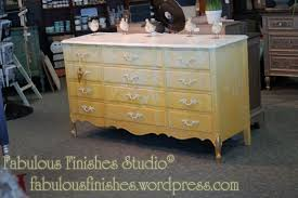 a dresser transformed using 6 colors from american paint company