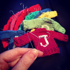 i knitted these miniature sweater ornaments for my